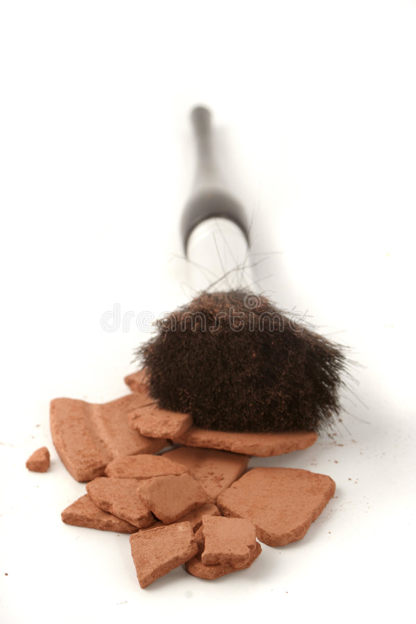 Bronzer and brushes. Beauty brushes and self tanning bronzer (shallow DOF stock photos