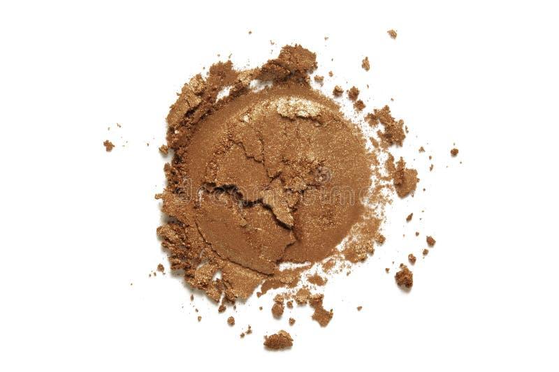 Bronzer o textura de la sombra de ojos Muestra marrón desnuda estrellada del polvo de cara del reflejo aislada en el fondo blanco fotos de archivo