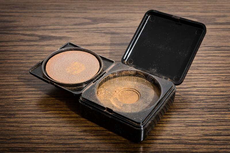 Bronzer powder cosmetic on the table. Bronzer powder cosmetic fully opened on the wooden table. Slovakia royalty free stock images