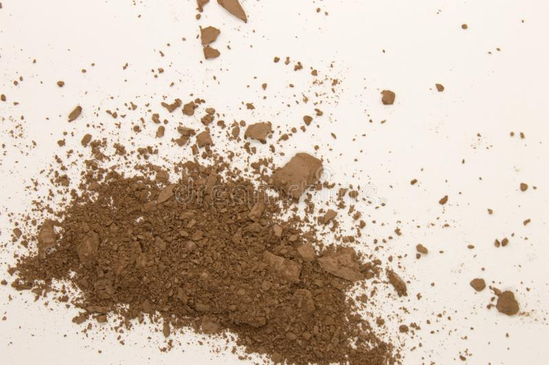 Bronzer powder. This is a photograph of a Bronzer powder makeup isolated on a White background royalty free stock photos