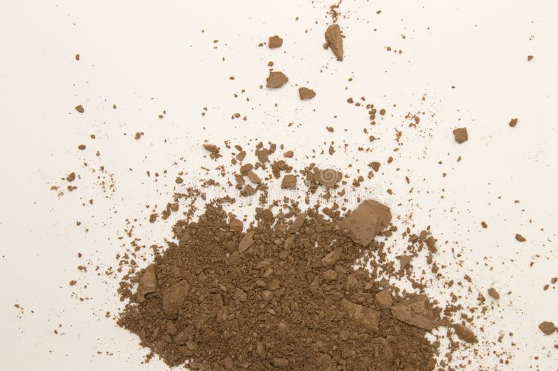 Bronzer powder. This is a photograph of a Bronzer powder makeup isolated on a White background royalty free stock image