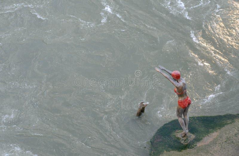 Bronze Sculpture of Diving Swimmer,Stone Bridge, Skopje, Macedonia royalty free stock image