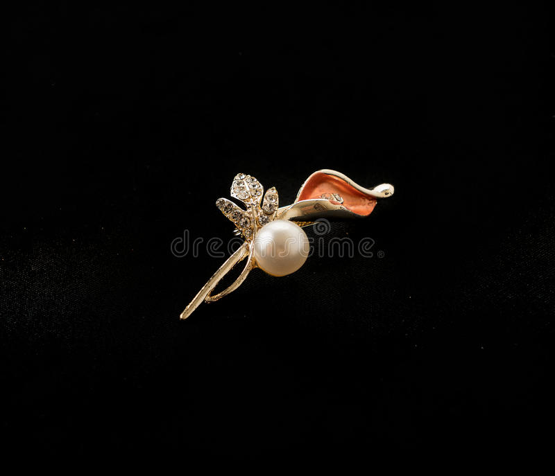 Brooch on black background royalty free stock photo