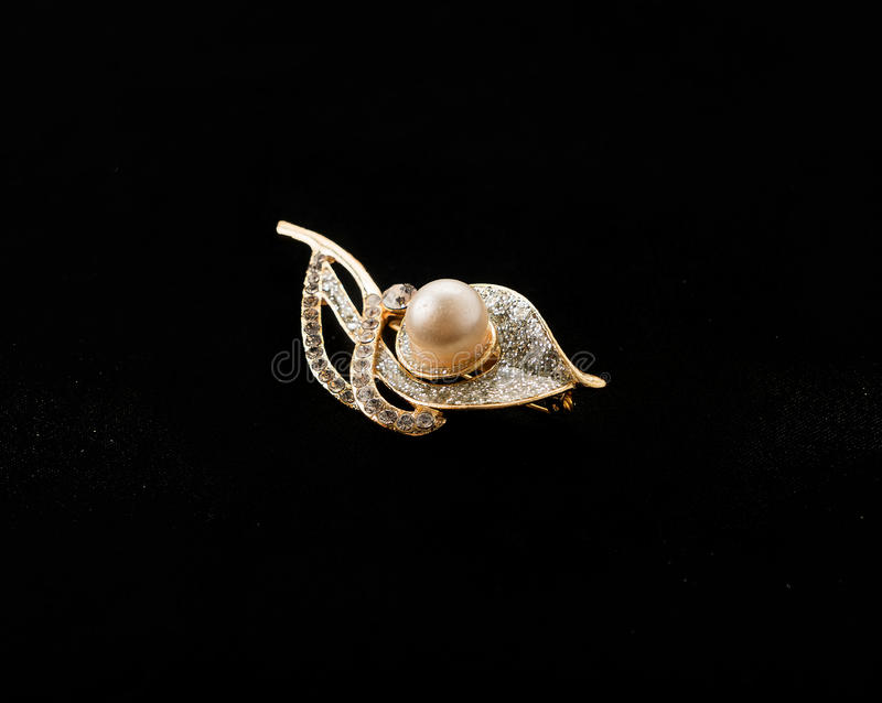 Brooch on black background royalty free stock images