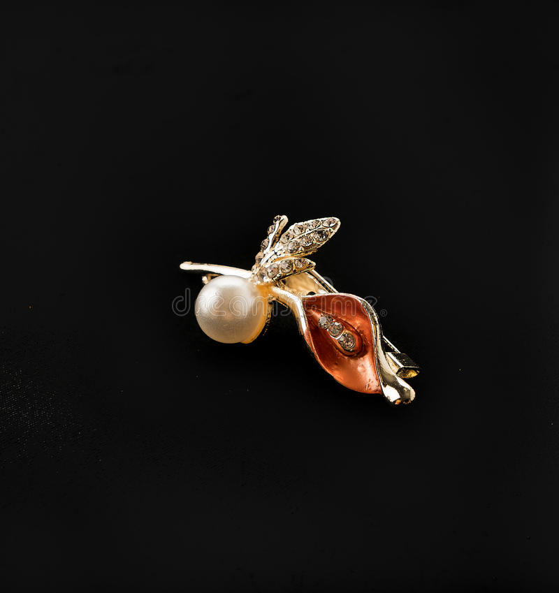 Brooch on black background stock photography