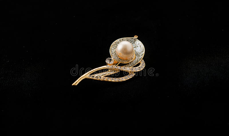 Brooch on black background royalty free stock photos