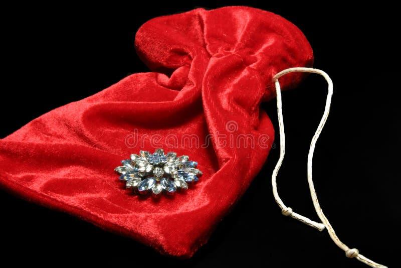 Brooch on velvet bag stock image