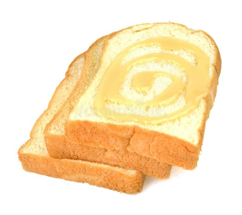 Brood, boter, room, gezoete condens Witte achtergrond royalty-vrije stock afbeeldingen