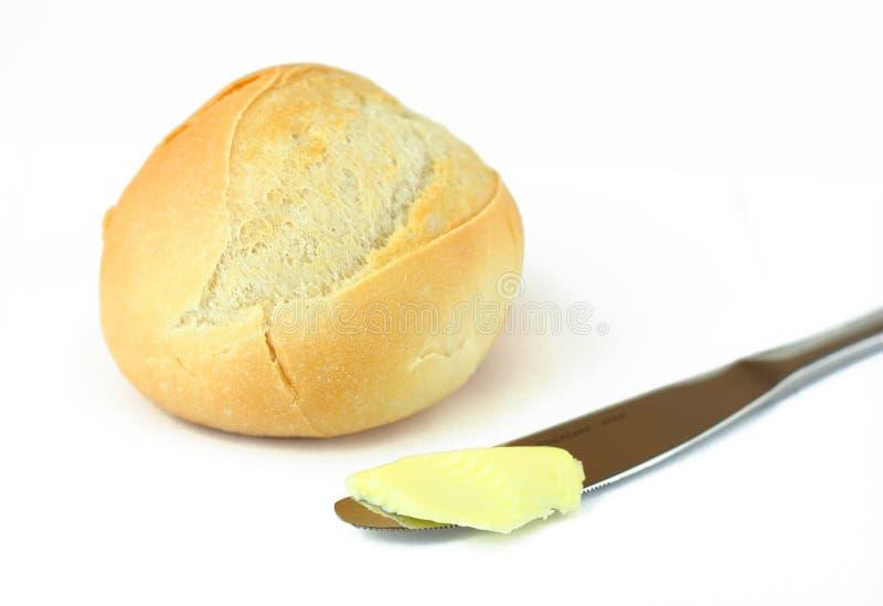 Brood en boter die op wit wordt geïsoleerd royalty-vrije stock foto