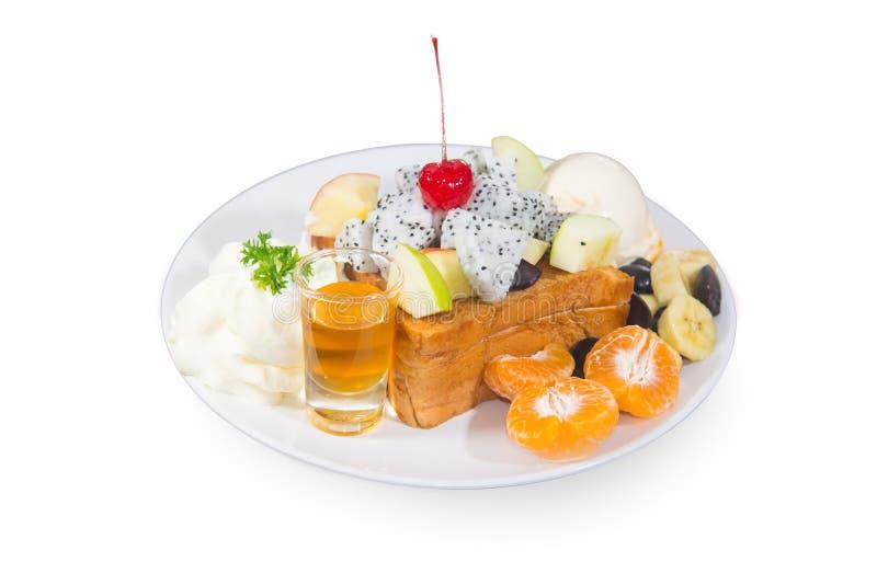 Broodboter met fruit het toping en honingsvloeistof royalty-vrije stock foto's