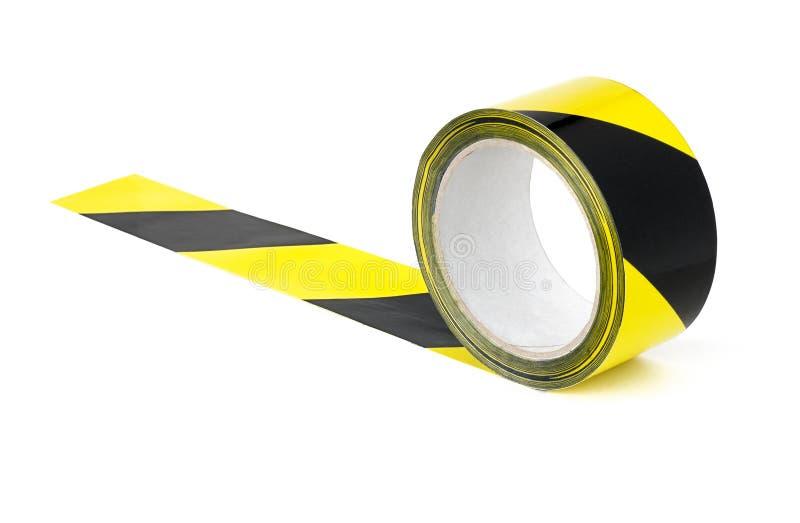 Gele en zwarte voorzichtigheidsband royalty-vrije stock foto's