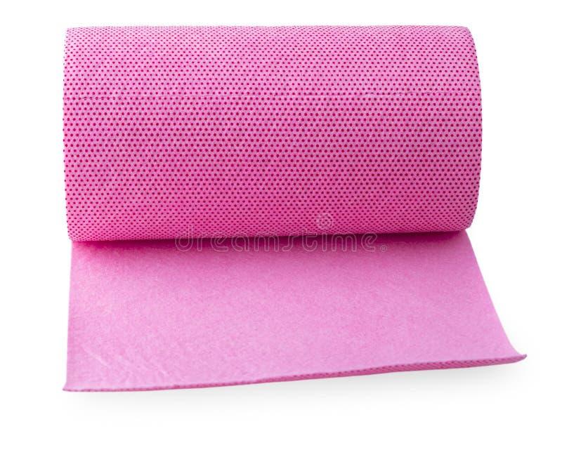 Broodje van roze gekleurde verpakkende folie op witte achtergrond royalty-vrije stock fotografie