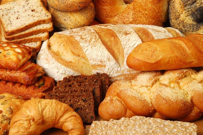 Broodjes, brood en cakes stock fotografie