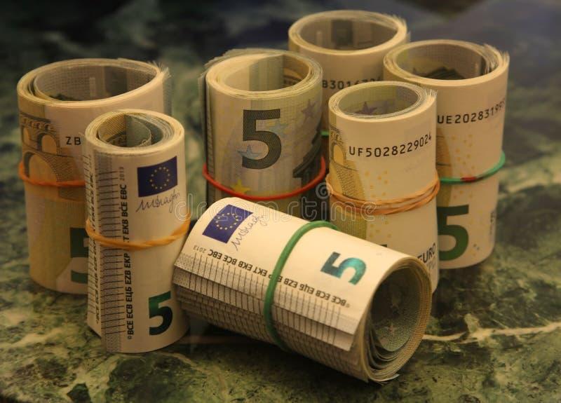 Broodjes van nota's van 5 euro stock afbeelding