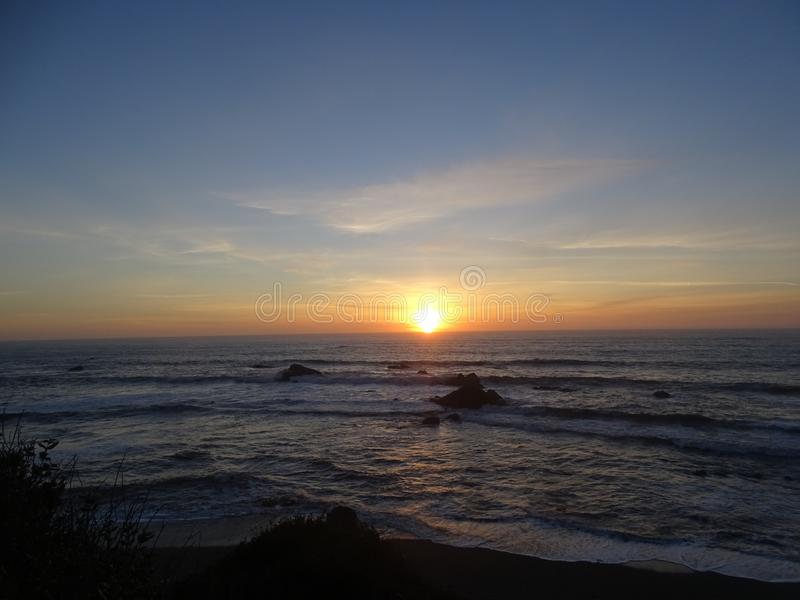 Brookings, Oregon sunset on beach. Sunnet on the beack in Brookings, Oregon royalty free stock image
