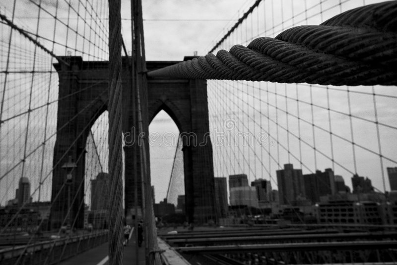 Brooklyn Bridge. With ropes and cables. New York skyline in the background - converted to black and white for more drama - New York 2007 stock photo