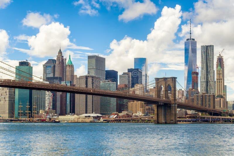 The Brooklyn Bridge and the downtown Manhattan skyline in New Yo. Rk City stock photos