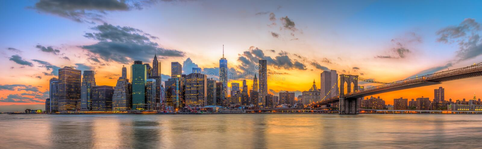 Brooklyn bridge and downtown New York City in beautiful sunset royalty free stock images