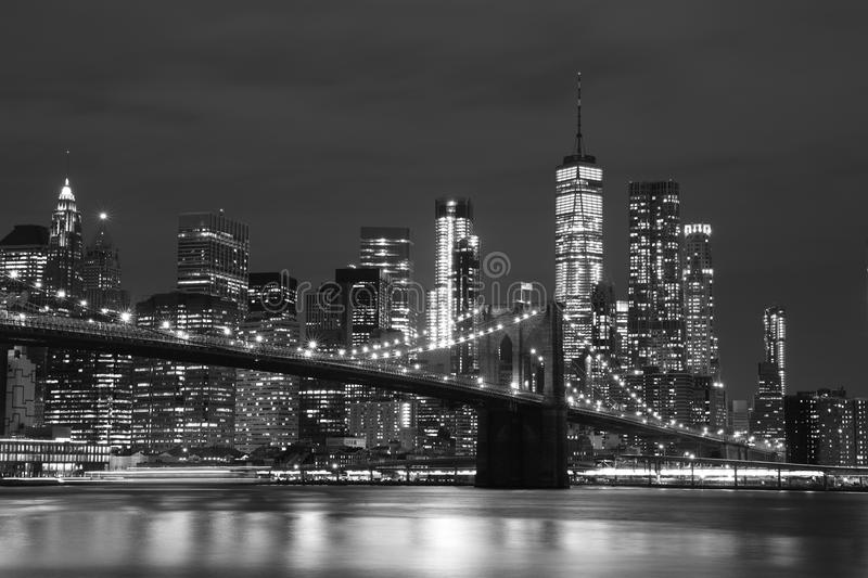 Brooklyn Bridge and Downtown Skyscrapers in New York, black and white stock photography