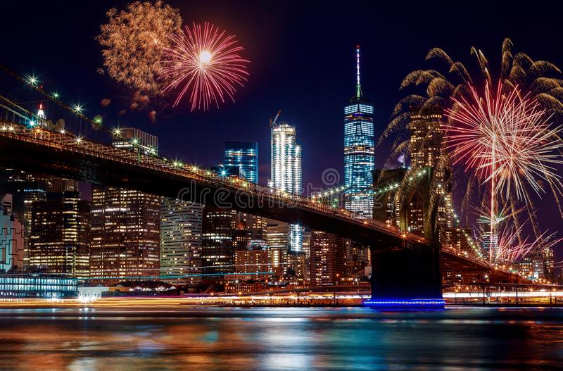 Brooklyn Bridge at dusk in New York City Colorful and vibrant fireworks. Colorful and vibrant fireworks at dusk Manhattan skyline from the Brooklyn Bridge in stock images