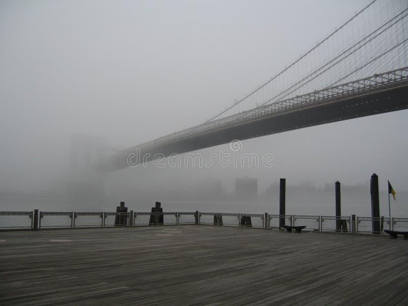 Brooklyn bridge in a fog royalty free stock photography