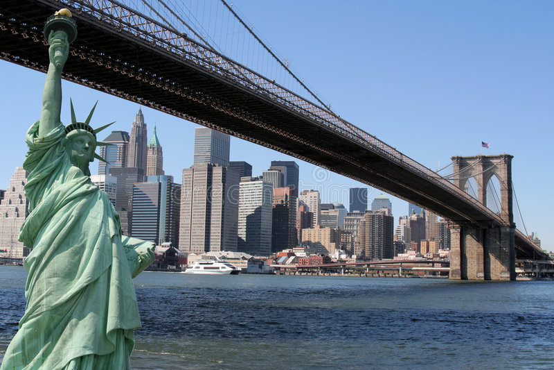 Brooklyn Bridge, Manhattan skyline and the Statue stock photo