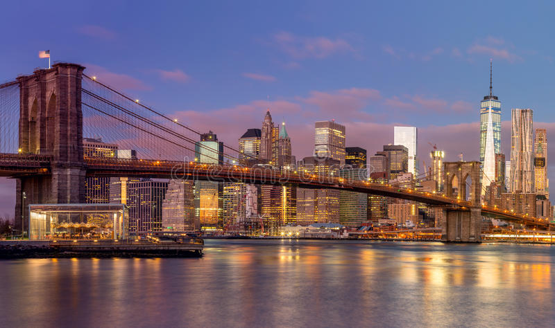 Brooklyn Bridge and Manhattan skyscrapers at sunrise, New York stock image