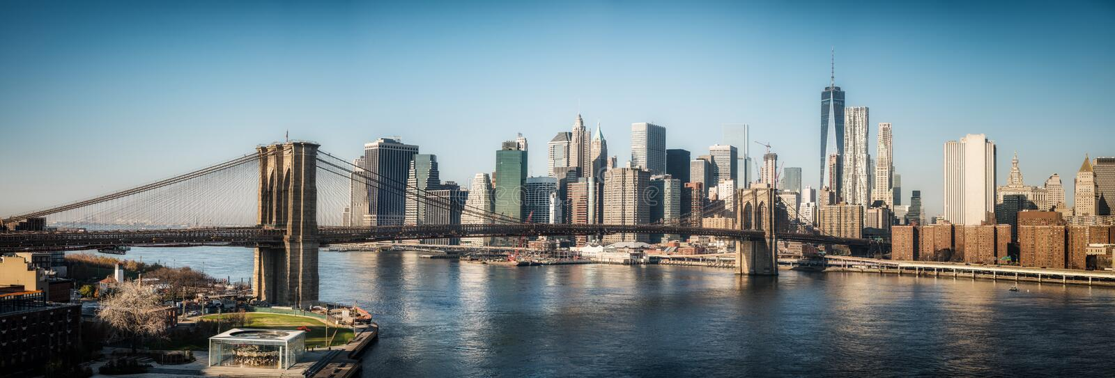 Brooklyn bridge and Manhattan at sunny day royalty free stock images