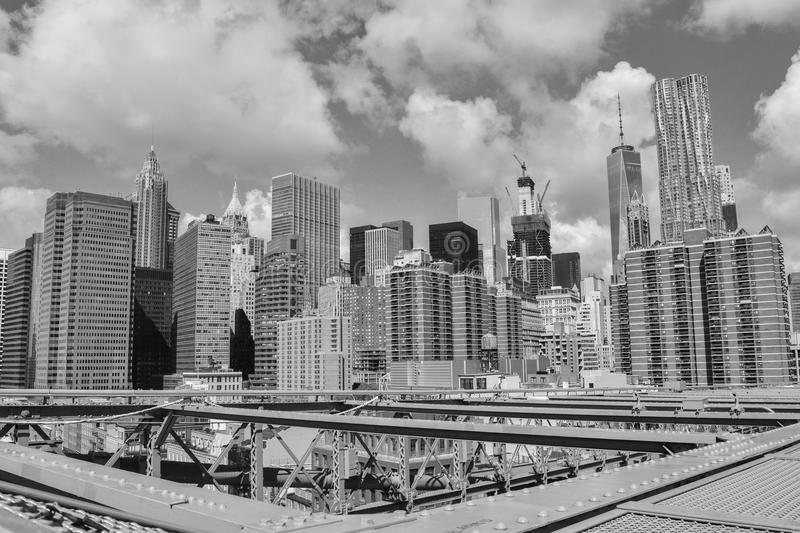 Brooklyn Bridge meets the high-rise buildings royalty free stock images