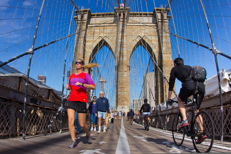 Brooklyn Bridge. NEW YORK CITY - SEPT 16: The pedestrian walkway along The Brooklyn Bridge in New York City on Sept 16, 2012. Approximately 4,000 pedestrians and stock image