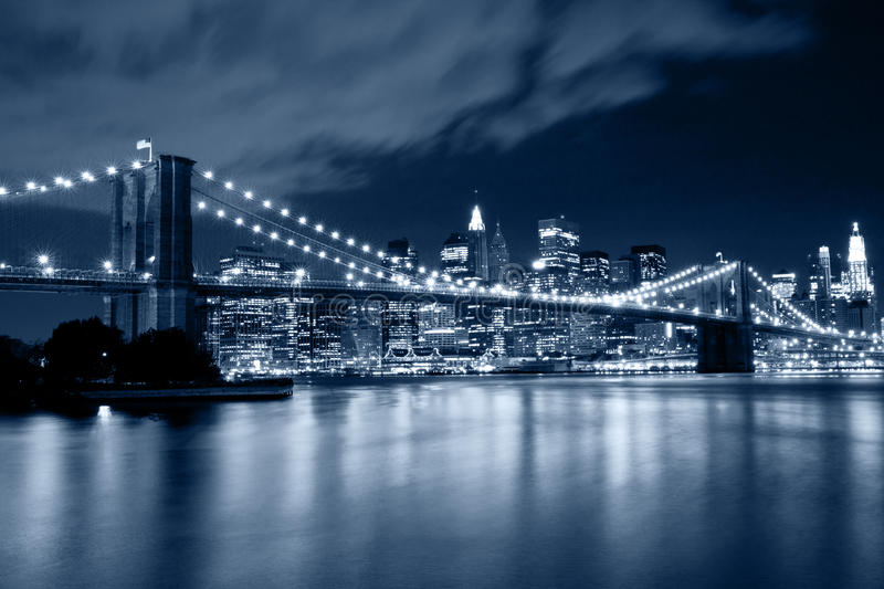 Brooklyn Bridge in New York with lights reflections on water stock photography