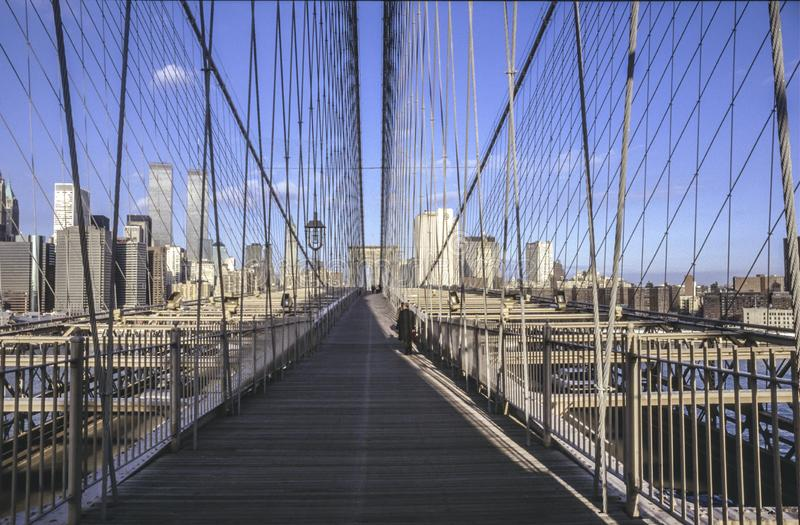 Brooklyn bridge in New York with twin towers in background stock photography