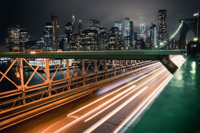 Brooklyn Bridge by night. Fast lanes by night Brooklyn New York stock image