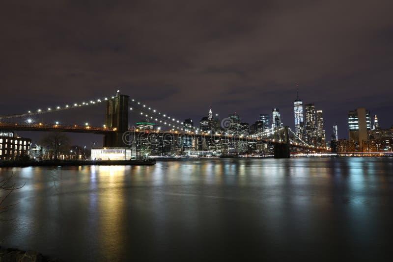 Brooklyn Bridge at night in New York stock images