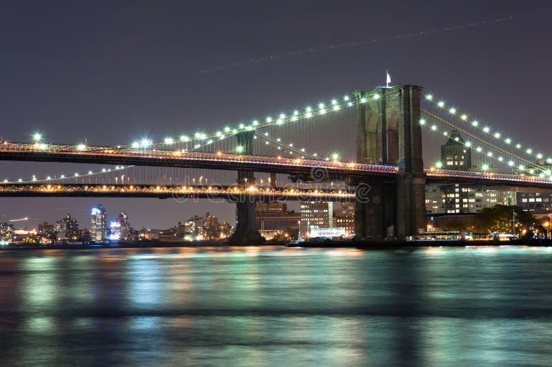 Brooklyn Bridge at Night. Night Walk on East River near Brooklyn and Manhattan Bridge, New York City stock images