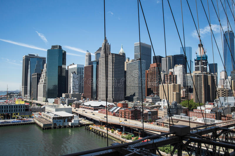 Brooklyn Bridge, One World Trade Center and Financial District: Summer in Manhattan royalty free stock images