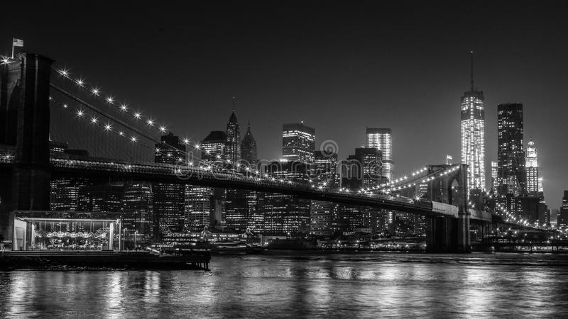 Brooklyn bridge. A perfect B&W night view of Brooklyn bridge and the new york citys financial district