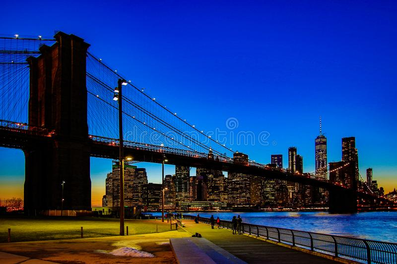 Brooklyn Bridge, seen from Dumbo Park after sunset, during the. BROOKLYN, NEW YORK, MAR 27, 2018: Brooklyn Bridge, seen from Dumbo Park after sunset, during the stock images