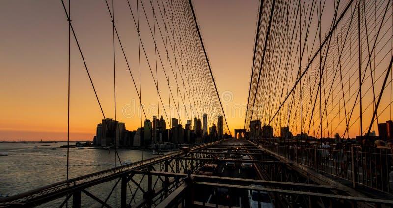 Brooklyn Bridge sunset with Manhattan skyline. In New York royalty free stock photos
