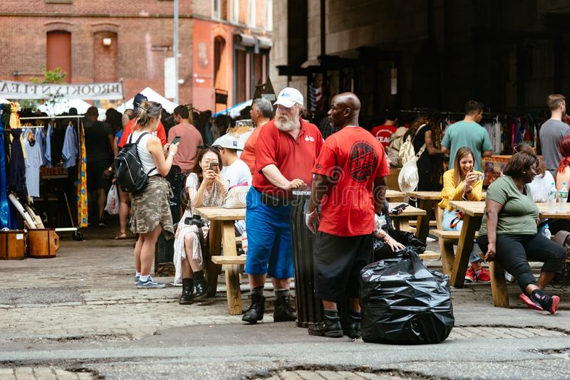 Brooklyn Flea Market in DUMBO in New York. New York City, USA - June 24, 2018: Brooklyn Flea Market in DUMBO. It includes vendors of furniture, vintage clothing stock image