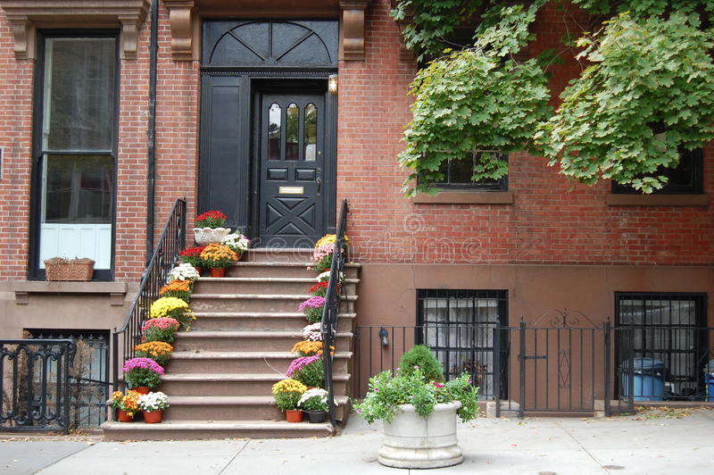 Brooklyn Home. A brick building with brownstone steps typical of old architecture in Brooklyn, New York stock photography