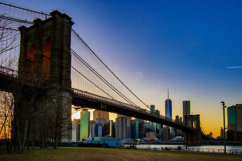 Brooklyn Bridge, seen from Dumbo Park after sunset, during the. BROOKLYN, NEW YORK, MAR 27, 2018: Brooklyn Bridge, seen from Dumbo Park after sunset, during the stock photography