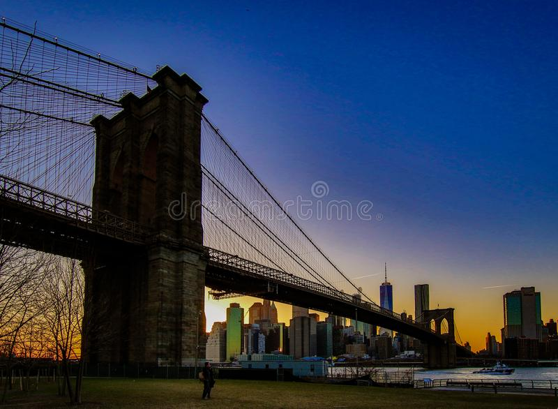 Brooklyn Bridge, seen from Dumbo Park after sunset, during the. BROOKLYN, NEW YORK, MAR 27, 2018: Brooklyn Bridge, seen from Dumbo Park after sunset, during the royalty free stock photos