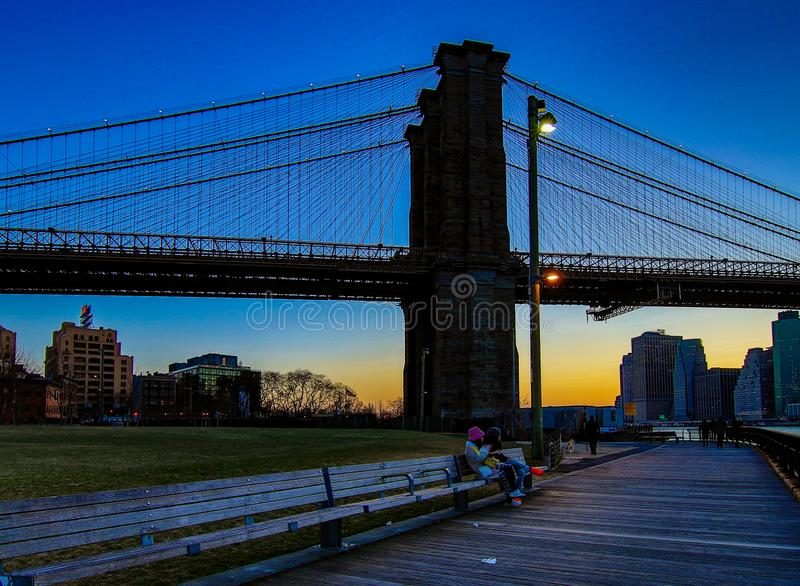 Brooklyn Bridge, seen from Dumbo Park after sunset, during the. BROOKLYN, NEW YORK, MAR 27, 2018: Brooklyn Bridge, seen from Dumbo Park after sunset, during the royalty free stock photo