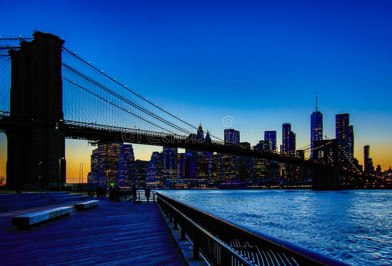 Brooklyn Bridge, seen from Dumbo Park after sunset, during the. BROOKLYN, NEW YORK, MAR 27, 2018: Brooklyn Bridge, seen from Dumbo Park after sunset, during the royalty free stock images