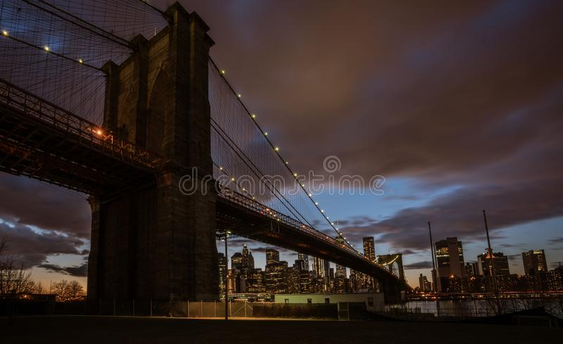 Brooklyn Bridge, seen from Dumbo Park at sunset. BROOKLYN, NEW YORK, MAR 27, 2018: Brooklyn Bridge, seen from Dumbo Park at sunset stock image