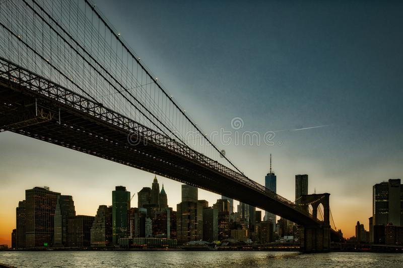 Brooklyn Bridge, seen from Dumbo Park at sunset. BROOKLYN, NEW YORK, MAR 27, 2018: Brooklyn Bridge, seen from Dumbo Park at sunset royalty free stock image