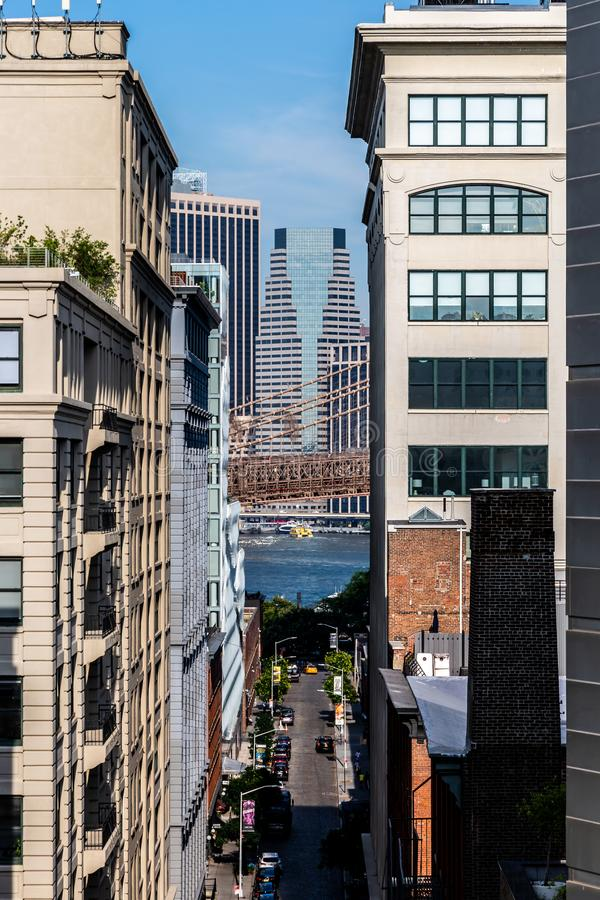 Brooklyn, NY / USA - JUL 31 2018: Buildings in Dumbo with Lower. Manhattan skyscrapers in background view royalty free stock images