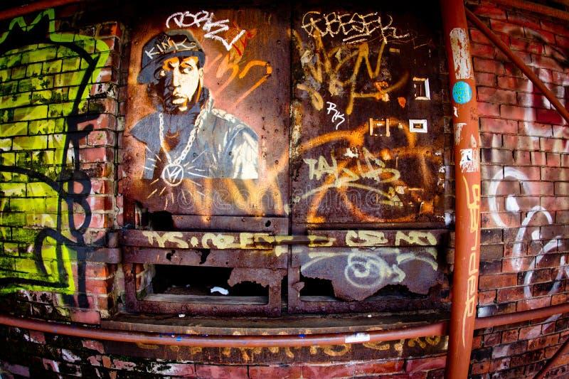 Brooklyn NYC Graffiti. BROOKLYN, NY - SEPT 16: Example of urban street art on landmark Empire Store Building in DUMBO Brooklyn, NY on Sept. 16, 2012. Artists stock photography