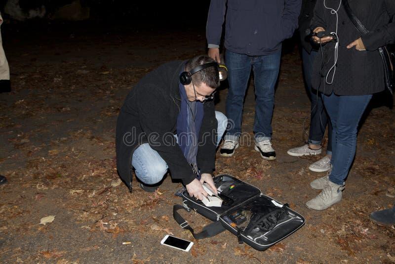 Brooklyn Paranormal Society during investigation. HUNTINGTON, NEW YORK, USA - NOVEMBER 14: Ron Yacovetti checks his equipment as other members of the Brooklyn stock photos